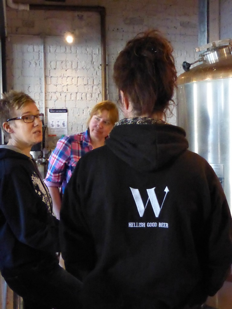 Sara from Triple fff (left), Anna from Zerodegrees Reading (centre) and Sue from Waen Brewery (back to camera) discuss brewing procedure.