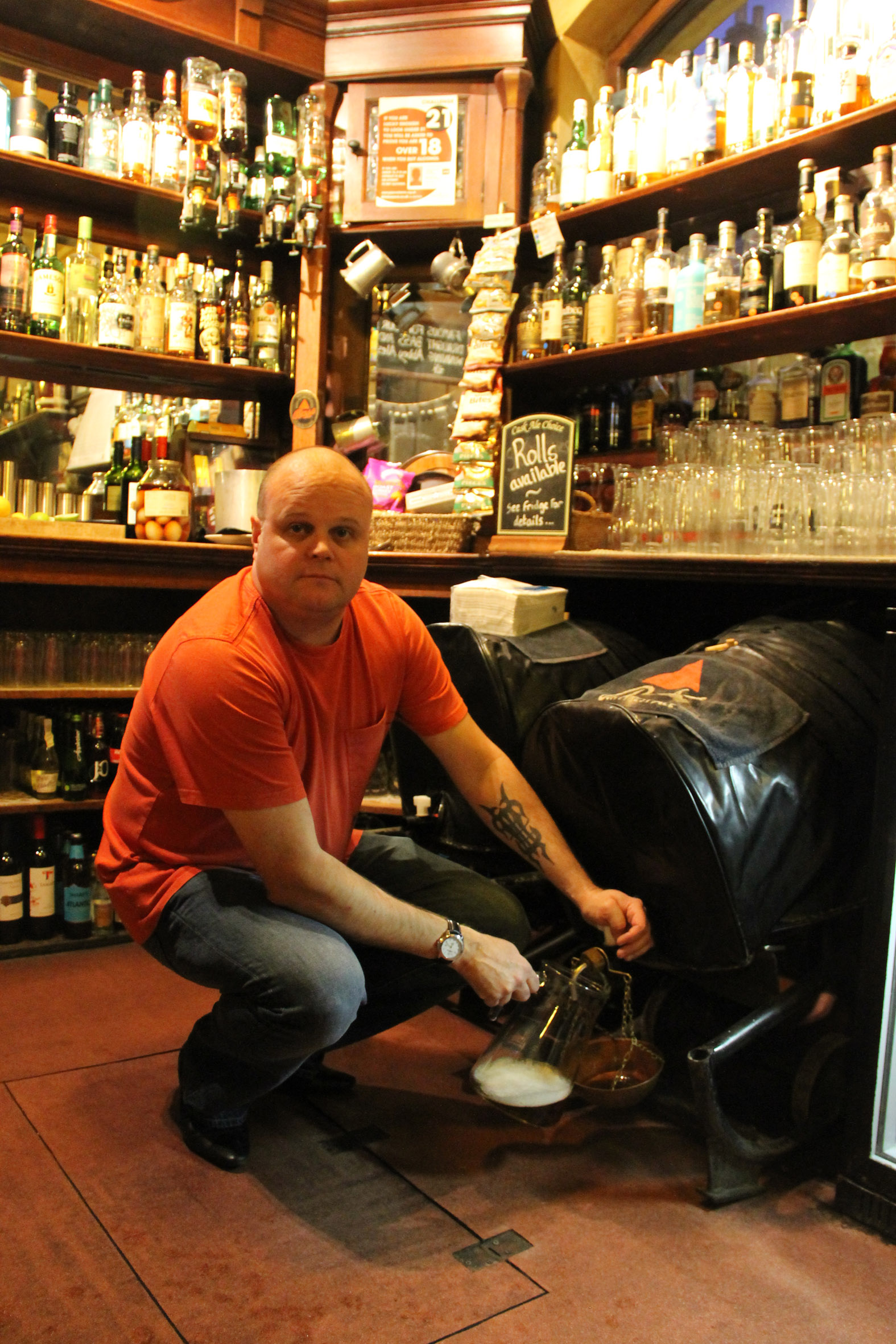 Paul Waters is usually happy serving beer - but here he sadly fills a jug from the barrel for almost the last time.